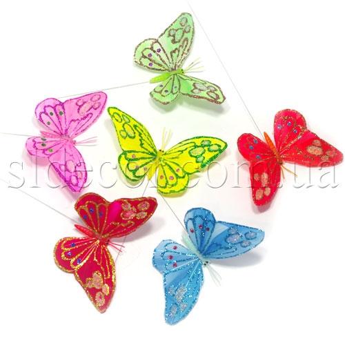 Бабочки из перьев