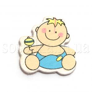 Наклейка ребенок с погремушкой